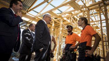 Prime Minister Scott Morrison and Housing Minister Michael Sukkar MP meet builders in the Melbourne suburb of Officer in February.