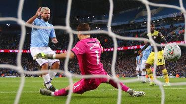 Sergio Aguero scores Manchester City's third goal past Alex McCarthy of Southampton at Etihad Stadium.