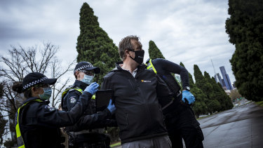 An anti-lockdown supporter is detained by Victoria Police after refusing to provide details and being in non-compliance with the Chief Health Officer's guidelines.