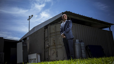 Greensborough Hockey Club president Greg Purcer outside his clubrooms, which he says are made up of two shipping containers joined to a shelter shed.