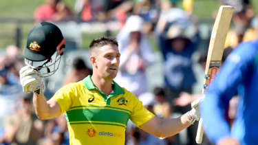 Shaun Marsh acknowledges the crowd after reaching his century at Adelaide Oval on Tuesday.