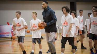 Happy campers: Ben Simmons on the ball for skill drills with young Australian talent at his camp.