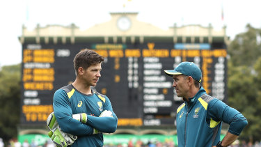 Tim Paine talking with Australia coach Justin Langer.