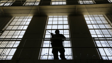 A guard stands watch over the east block of death row at San Quentin State Prison.