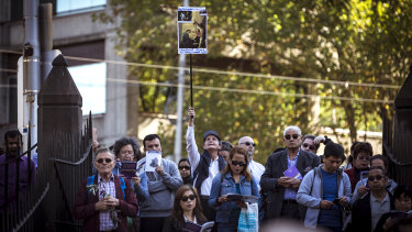 Christians, some with home-made signs, gathered to mark the stations of the cross.