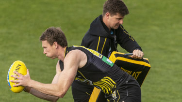On the prowl: Dylan Grimes puts in the hard yards during a Richmond training session at Punt Road Oval.