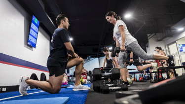 An F45 class in action in Sydney. The franchise utilises 45 minute workouts.