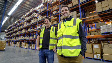 eBay's David Ramadge  and Australia Post's Ben Franzi at the Fulfilio fulfilment centre near Melbourne Airport.