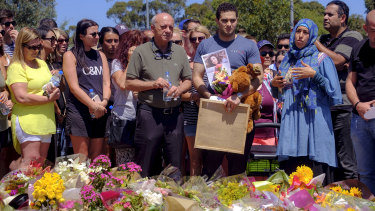 Saeed Maasarwe, the father of slain student Aiia Maasarwe, pays tribute to his daughter outside the Polaris shopping centre in Bundoora on Sunday.