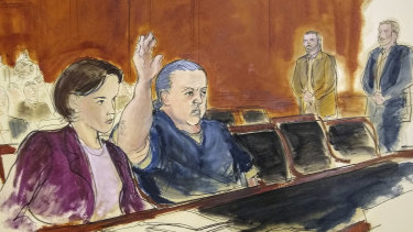 In this file courtroom sketch, Cesar Sayoc raises his arm to swear to the truth of his statement of need for assigned counsel, during his presentment in Manhattan Federal Court in New York.