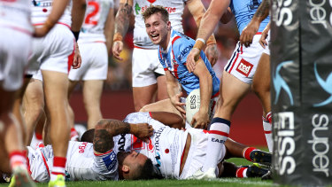 Sam Walker celebrates a try on Anzac Day.