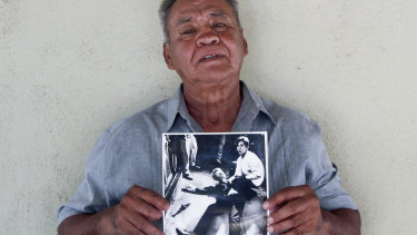 Juan Romero, 67, holds a photo of himself and the dying Senator Robert F. Kennedy at the Ambassador Hotel in Los Angeles, taken by the Los Angeles Times' Boris Yaro on at his home in Modesto, California.