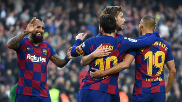 Lionel Messi celebrates with Martin Braithwaite, Arturo Vidal and Ivan Rakitic after scoring Barca's fourth goal.