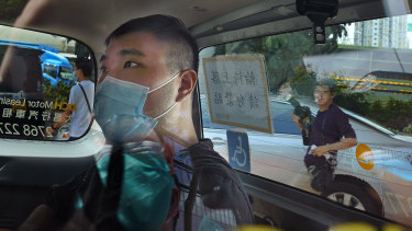 Tong Ying-kit arriving at a court in a police van in Hong Kong in July.