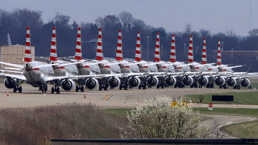 American Airlines planes stored at Pittsburgh International Airport sit idle on a closed taxiway.