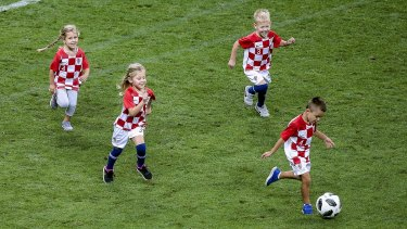 Youth development: Croatian players' children took to the field after their semi-final win.