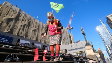 Protesters participate in an Extinction Rebellion rally in Melbourne on Saturday.
