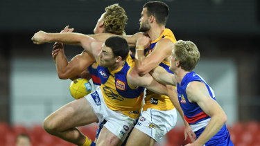 In the thick of it: Jeremy McGovern (front left) attempts a spoil during the Eagles narrow loss to the Bulldogs.