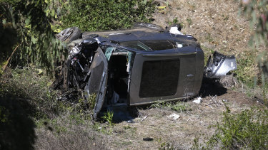 The vehicle rests on its side after a rollover accident involving golfer Tiger Woods along a road in the Rancho Palos Verdes section of Los Angeles.