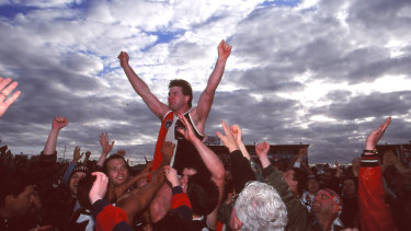 Danny Frawley chaired off after his last game in 1995.