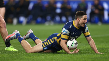 Mitchell Moses celebrates a try.