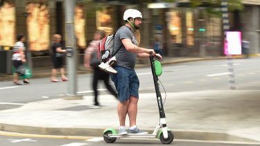A Lime scooter user on the streets of Brisbane last week.