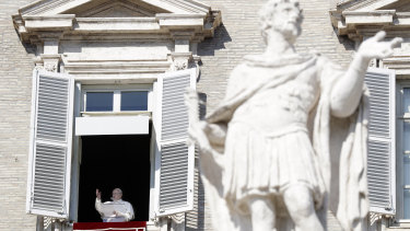 Pope Francis delivers his blessing during the Angelus noon prayer at the Vatican on Sunday.