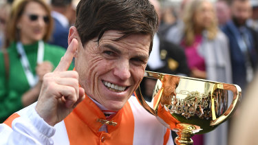 Vow and Declare's jockey Craig Williams declares victory at the 2019 Melbourne Cup.