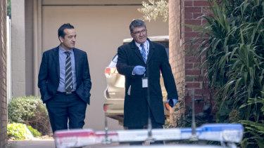 Homicide detectives outside the Park Street property.