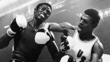 Spinks lets a right fly at Cuba's Sixto Soria during light heavyweight boxing action at the Olympics in Montreal.