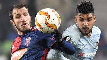 Vidi's Marko Scepovic (left) battles Chelsea's Emerson Palmieri.