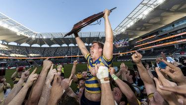 Sydney University's Guy Porter celebrates after winning back-to-back Shute Shield titles.