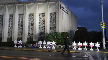 A Pittsburgh Police officer walks past the Tree of Life Synagogue.