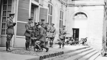 King George V knighting Sir John Monash at at the Australian Corps headquarters in France in 1918.