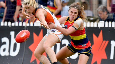 Jenna McCormick (right) has left the Adelaide Crows to return to soccer with Melbourne Victory.