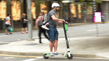 A Lime scooter user on the streets of Brisbane.