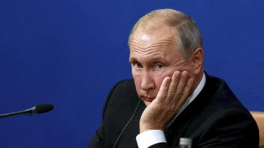 Assad's biggest backer: Russian President Vladimir Putin in Iran on Friday.
