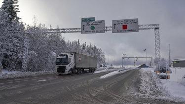 A truck passes the Norwegian border towards Sweden.