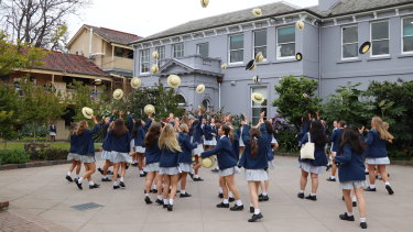 It's not a VCE results day blog unless there is at least one photo of students throwing hats into air.
