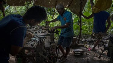 A gunsmith crafts a .45-calibre pistol by hand in a hut in the woods near Danao, Philippines. An estimated two million unregistered guns are owned in the country, more than the number of registered weapons.