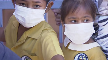 Masked children wait to get vaccinated at a health clinic in Apia, Samoa, in November.