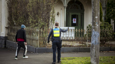 Police escort a resident of Hambleton House back to his residence after he left the property on Monday morning. Hambleton House is currently under lockdown after a COVID-19 outbreak.