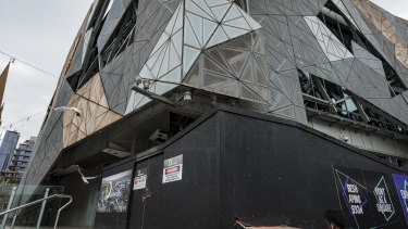 The front of ACMI at Federation Square is boarded up during renovation.