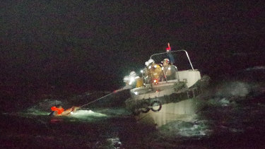 Japan's Coast Guard rescues a Filipino crew member of the Gulf Livestock 1 on Thursday.