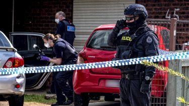 Police stand guard outside the house of Ali's parents home in Werribee in November 2018 after his older brother Hassan Khalif Shire Ali was involved in the Bourke Street terror attack.
