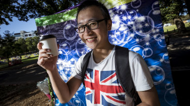 Ming from Shanghai gets ready for the fireworks in Yarra Park with a Melbourne coffee.
