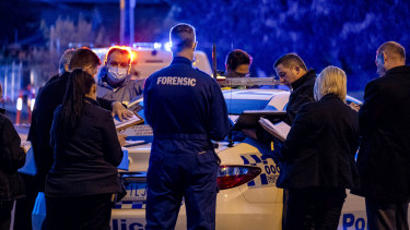 Forensic police at the scene of the stabbing in Kings Park on Saturday in which one boy was killed.
