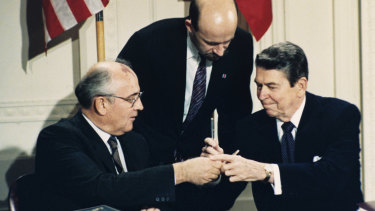 US President Ronald Reagan, right, and Soviet leader Mikhail Gorbachev exchange pens during the Intermediate Range Nuclear Forces Treaty signing ceremony in the White House in 1987.