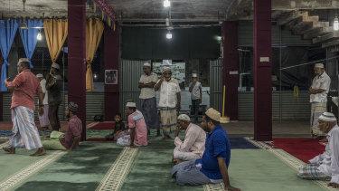 Men pray in the Badhiriy Yah Jumah Mosque. in Kattankudy, Sri Lanka.