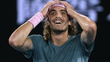 Greece's Stefanos Tsitsipas  celebrates after beating Roger Federer.